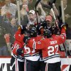 Chicago Blackhawks\' Marcus Kruger (16), left, celebrates with teammates after scoring a goal during the third period of Game 1 of an NHL hockey playoffs Western Conference semifinal against the Detroit Red Wings in Chicago, Wednesday, May 15, 2013. (AP Photo/Nam Y. Huh)