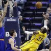 Photo - Indiana Pacers guard C.J. Watson, right, attempts a shot in front of New York Knicks guard Beno Udrih during the first half of an NBA basketball game in Indianapolis, Thursday, Jan. 16, 2014. (AP Photo/Michael Conroy)