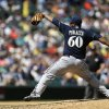 Photo - Milwaukee Brewers starting pitcher Wily Peralta throws in the fifth inning of a baseball game against the Seattle Mariners, Sunday, Aug. 11, 2013, in Seattle. (AP Photo/Ted S. Warren)