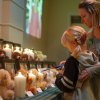 Betsy S. Willson and her daughter Savannah R. Robinson light a candle for Josephine Gay during a vigil in Pearland, Texas Friday, Dec. 21, 2012. (AP Photo/The Courier, Kirk Sides) ORG XMIT: TXCON105