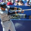 Photo - Detroit Tigers' Miguel Cabrera hits a single against the Toronto Blue Jays during the first inning of a baseball game on Sunday, Aug. 10, 2014, in Toronto.  (AP Photo/The Canadian Press, Jon Blacker)