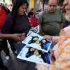 A man sells prints at 20 bolivars each, about 3.00 U.S. dollars, of one of the photographs released Friday by the Venezuelan government showing President Hugo Chavez with his daughters Maria Gabriela, left, and Rosa Virginia, right, at Bolivar square in Caracas, Venezuela, Friday, Feb. 15, 2013. Amid widespread speculation and rumors in Venezuela about Chavez\'s delicate condition following his Dec. 11 cancer surgery, the government released the first photos of the ailing president in more than two months on Friday, presenting images of him smiling alongside his daughters in Cuba. (AP Photo/Fernando Llano)