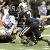 Georgetown quarterback Jake Hubenak (10) is tackled by a group of Denton Guyer defenders, including Terrell Singleton (7), in the first half during the UIL Class 4A Division I high school football championship game, Saturday, Dec. 22, 2012, in Arlington, Texas. (AP Photo/Matt Strasen)