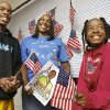 From left, student Elmer LuGrand, Jr., teacher Marie Grubbs and student Rashee Turner in Grubbs\' classroom after watching the inauguration. Students and teachers at Boley Public Schools in the historically black community of Boley in Okfuskee County celebrated the inauguration of Barack Obama as the 44th president of the United States Tuesday, Jan. 20, 2009. BY JIM BECKEL, THE OKLAHOMAN ORG XMIT: KOD