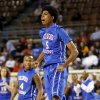 Millwood\'s Ashford Golden reacts to a basket during the 3A boys semifinal game between the Millwood High School Falcons and the Centennial Bison at the State Fair Arena on Friday, March 8, 2013 in Oklahoma City, Okla. Photo by Steve Sisney, The Oklahoman