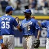 Kansas City Royals\' Lorenzo Cain, center, high-fives teammate Eric Hosmer, left, after the Royals defeated the Atlanta Braves 1-0 in a baseball game, Wednesday, April 17, 2013, in Atlanta. (AP Photo/David Goldman)