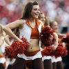 The Texas pom squad dances during the Red River Rivalry college football game between the University of Oklahoma Sooners and the University of Texas Longhorns at the Cotton Bowl Stadium in Dallas, Saturday, Oct. 12, 2013. UT won, 36-20. Photo by Nate Billings, The Oklahoman