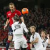 Photo - Lille's David Rozehnal, top, heads the ball during his French League one soccer match against Rennes at the Lille Metropole stadium, in Villeneuve d'Ascq, northern France, Friday, Jan. 24, 2014. (AP Photo/Michel Spingler)