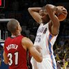 Oklahoma City\'s Kevin Durant (35) keeps the ball away from Miami\'s Shane Battier (31) during the NBA basketball game between the Miami Heat and the Oklahoma City Thunder at Chesapeake Energy Arena in Oklahoma City, Sunday, March 25, 2012. Oklahoma City won, 103-87. Photo by Nate Billings, The Oklahoman