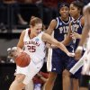 Whitney Hand dribble past Pitt defenders in the first half of the NCAA women\'s basketball tournament game between the University of Oklahoma and Pittsburgh at the Ford Center in Oklahoma City, Okla. on Sunday, March 29, 2009. PHOTO BY STEVE SISNEY, THE OKLAHOMAN