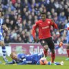 Photo - Cardiff City's Wilfried Zaha, centre, runs for the ball as Wigan Athletic's Ben Watson falls to the pitch during their FA Cup, Fifth round soccer match at The Cardiff City Stadium, Cardiff, Wales, Saturday Feb. 15, 2014. (AP Photo / PA ) UNITED KINGDOM OUT - NO SALES - NO ARCHIVES