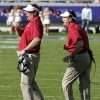 Defensive coordinator Mike Stoops and head coach Bob Stoops yell to the defense in the final minutes of the second half of the college football game where the University of Oklahoma Sooners (OU) defeated the Texas Christian University Horned Frogs (TCU) 24-17 at Amon G. Carter Stadium in Fort Worth, Texas, on Saturday, Dec. 1, 2012. Photo by Steve Sisney, The Oklahoman