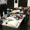 This image provided by the Los Angeles Police Department shows officials seizing material from the luggage of Yongda Huang Harris after he atempted to enter the United States at Los Angeles International Airport. A detention hearing was held Friday Oct. 12, 2012 for Harris where he was remanded back into custody. (AP Photo/LAPD)