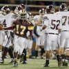 Clinton\'s Donivien Brown celebrates a fumble recovery during the high school playoff game between Ada and Clinton at Putnam City High School in Oklahoma City, Friday, Nov. 23, 2012. Photo by Sarah Phipps, The Oklahoman