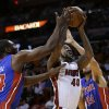 Photo - Miami Heat forward Udonis Haslem (40) grabs a rebound against Detroit Pistons forwards Jason Maxiell (54) and Tayshaun Prince (22) during the first half of an NBA basketball game, Friday, Jan. 25, 2013, in Miami. (AP Photo/Wilfredo Lee)