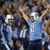 Tennessee Titans kicker Rob Bironas (2) reacts with holder Brett Kern (6) after kicking the game-winning field goal in the fourth quarter of an NFL football game against the Pittsburgh Steelers on Thursday, Oct. 11, 2012, in Nashville, Tenn. The Titans won 26-23. (AP Photo/Joe Howell)