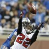 Photo - Atlanta Falcons cornerback Asante Samuel (22) intercepts a pass intended for Detroit Lions wide receiver Calvin Johnson, rear, during the fourth quarter of an NFL football game at Ford Field in Detroit, Saturday, Dec. 22, 2012. (AP Photo/Duane Burleson)