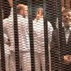 Photo - FILE - This Monday, Nov. 4, 2013 file image made from video provided by Egypt's Interior Ministry shows ousted President Mohammed Morsi, right, speaking from the defendant's cage as he stands with co-defendants in a makeshift courtroom during a trial hearing in Cairo, Egypt. Egypt's crackdown on Islamists has jailed 16,000 people over the past eight months in the country's biggest round-up in nearly two decades, according to previously unreleased figures from security officials. Rights activists say reports of abuses in prisons are mounting, with prisoners describing systematic beatings and miserable conditions for dozens packed into tiny cells. (AP Photo/Egyptian Interior Ministry, File)