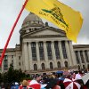 A flag flies during a Health Care Reform march and rally on the north side of the State Capitol in Oklahoma City on Sunday, Sept. 13, 2009. By John Clanton, The Oklahoman