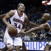 iAtlanta Hawks point guard Devin Harris (34) is fouled by Utah Jazz point guard Jamaal Tinsley (6) while driving to the basket in the second half of an NBA basketball game on Friday, Jan. 11, 2013, in Atlanta. Atlanta won 103-95. (AP Photo/John Bazemore)