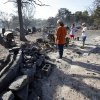 The remains of Harold (left) and Vicky Grigg\'s home and outbuildings at 6830 132nd Street still smolder from Friday\'s wildfire on Saturday, Aug. 4, 2012, in Slaughterville, Okla. Vicky\'s brother Ricky Oliver (right) lived next door with their ailing mother. That house as also burned to the ground. Photo by Steve Sisney, The Oklahoman