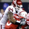 Oklahoma\'s Frank Alexander (84) sacks Nebraska quarterback Taylor Martinez (3) during the Big 12 football championship game between the University of Oklahoma Sooners (OU) and the University of Nebraska Cornhuskers (NU) at Cowboys Stadium on Saturday, Dec. 4, 2010, in Arlington, Texas. Photo by Chris Landsberger, The Oklahoman