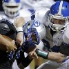 Deer Creek\'s Kooper Ruminer tackles Guthrie\'s Bryan Dutton during the high school football game between Guthrie and Deer Creek at Guthrie, Thursday, Oct. 18, 2012. Photo by Sarah Phipps, The Oklahoman