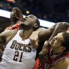 Milwaukee Bucks\' Samuel Dalembert (21) and Chicago Bulls\' Joakim Noah, right, battle for a rebound during the second half of an NBA basketball game Wednesday, Jan. 30, 2013, in Milwaukee. (AP Photo/Jeffrey Phelps)