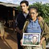 """In this Nov. 14, 2012 photo, Isabel Iglesias, 56, right, holds a picture of her late husband Avelino Espinola as she poses for a portrait with her son Andres, 14, at their home in the Yvy Pyta settlement near Curuguaty, Paraguay. Iglesias\'s husband Avelino Espinola was killed during the """"Massacre of Curuguaty"""" on June 15 when negotiations between farmers occupying a rich politician\'s land ended with a barrage of bullets that killed 11 farmers and 6 police officers. (AP Photo/Jorge Saenz)"""