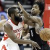 Houston Rockets\' James Harden (13) tries to pass the ball around Minnesota Timberwolves\' Mickael Gelabale (15) in the first half of an NBA basketball game Friday, March 15, 2013, in Houston. (AP Photo/Pat Sullivan)