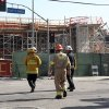 Photo - Los Angeles Firefighters arrive at the site of a parking structure under construction that collapsed Friday March 28, 2014 in Los Angeles. A section of the parking structure under collapsed, but authorities say it appears no one was hurt. (AP Photo/Nick Ut)