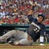 Photo - Milwaukee Brewers' Carlos Gomez scores during the fifth inning of a baseball game against the St. Louis Cardinals Saturday, Aug. 2, 2014, in St. Louis. (AP Photo/Jeff Roberson)