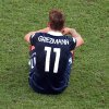 Photo - France's Antoine Griezmann sits on the pitch after the World Cup quarterfinal soccer match between Germany and France at the Maracana Stadium in Rio de Janeiro, Brazil, Friday, July 4, 2014. Germany won 1-0. (AP Photo/Francois Xavier Marit, pool)