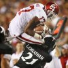 Mossis Madu (17) leaps over Camerron Cheatham (22) during the second half of the college football game between the University of Oklahoma Sooners (OU) and the University of Cincinnati Bearcats (UC) at Paul Brown Stadium on Saturday, Sept. 25, 2010, in Cincinnati, Ohio. Photo by Steve Sisney, The Oklahoman