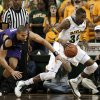 Baylor forward Cory Jefferson (34) grabs a loose ball and drives to the basket against Northwestern guard Drew Crawford during the first half of an NCAA college basketball game Tuesday, Dec. 4, 2012, in Waco, Texas. (AP Photo/Tony Gutierrez)