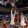 Oklahoma\'s Romero Osby (24) grabs a rebound against San Diego State\'s Jamaal Franklin (21) next to Chase Tapley (22) and Oklahoma\'s Amath M\'Baye (22) during a game between the University of Oklahoma and San Diego State in the second round of the NCAA men\'s college basketball tournament at the Wells Fargo Center in Philadelphia, Friday, March 22, 2013. San Diego State beat OU, 70-55. Photo by Nate Billings, The Oklahoman