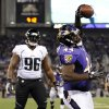 Photo -   Baltimore Ravens running back Vonta Leach, right, celebrates in front of Jacksonville Jaguars defensive tackle Terrance Knighton after scoring a touchdown in the second half of an NFL preseason football game in Baltimore, Thursday, Aug. 23, 2012. (AP Photo/Nick Wass)