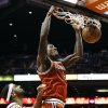 Milwaukee Bucks\' Larry Sanders dunks past Phoenix Suns\' Jared Dudley, left, and Marcin Gortat (4), of Poland, during the first half of an NBA basketball game, Thursday, Jan. 17, 2013, in Phoenix. (AP Photo/Ross D. Franklin)