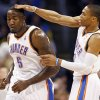 Oklahoma City\'s Russell Westbrook (0) pats Kendrick Perkins (5) on the head after Perkins made a basket during an NBA basketball game between the Oklahoma City Thunder and Minnesota Timberwolves at Chesapeake Energy Arena in Oklahoma City, Friday, Feb. 22, 2013. Oklahoma City won, 127-111. Photo by Nate Billings, The Oklahoman