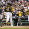 Photo - Pittsburgh Pirates' Gregory Polanco (25) heads home to score with Josh Harrison, right, and Ike Davis on a triple by Gregory Polanco in the first inning of the baseball game against the Detroit Tigers on Monday, Aug. 11, 2014, in Pittsburgh. Tigers catcher Alex Avila is at left. (AP Photo/Keith Srakocic)