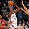 Oklahoma City\'s Kevin Durant is pressured by Philadelphia\'s Andre Iguodala and Jason Kapono during the second half of their NBA basketball game at the Ford Center in Oklahoma City on Tuesday, Dec. 2, 2009. The Thunder beat the 76ers 117 to 106. By John Clanton, The Oklahoman