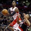 Toronto Raptors guard Terrence Ross, left, is fouled by Portland Trail Blazers guard Damian Lillard as he drives to the basket during the first half of an NBA basketball game in Toronto, Wednesday, Jan. 2, 2013. (AP Photo/The Canadian Press, Frank Gunn)