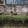 Photo - Kenya security forces are seen behind a wall outside the Westgate Mall in Nairobi, Kenya Monday morning, Sept. 23, 2013. Kenya's military launched a major operation at the upscale Nairobi mall and said it had rescued