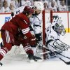 Phoenix Coyotes center Boyd Gordon, left, has his shot deflected by Los Angeles Kings goalie Jonathan Quick as Willie Mitchell (33) defends during the first period of Game 5 of the NHL hockey Stanley Cup Western Conference finals, Tuesday, May 22, 2012, in Glendale, Ariz. (AP Photo/Matt York)