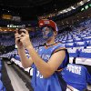 Johnathan Cowen, 13, of Tulsa, Okla., takes pictures of warm ups before game 3 of the Western Conference Finals of the NBA basketball playoffs between the Dallas Mavericks and the Oklahoma City Thunder at the OKC Arena in downtown Oklahoma City, Saturday, May 21, 2011. Photo by Sarah Phipps, The Oklahoman