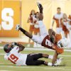 Texas\' Fozzy Whittaker (2) gets tripped up by Oklahoma State\'s Brodrick Brown (19) in the second half during a college football game between the Oklahoma State University Cowboys (OSU) and the University of Texas Longhorns (UT) at Darrell K Royal-Texas Memorial Stadium in Austin, Texas, Saturday, Oct. 15, 2011. OSU won, 38-26. Photo by Nate Billings, The Oklahoman ORG XMIT: KOD