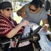 Photo - Daughter Christina Morales helps her mother, Edith Morales, get out of her wheelchair-accessible van after a visit to the hospital. The van was given to Edith Morales by Catholic Charities. PHOTO BY NATE BILLINGS, THE OKLAHOMAN.  NATE BILLINGS