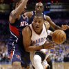 Oklahoma City Thunder\'s Russell Westbrook (0) drives past Atlanta Hawk\'s Jeff Teague (0) as the Oklahoma City Thunder play the Atlanta Hawks in NBA basketball at the Chesapeake Energy Arena in Oklahoma City, on Sunday, Nov. 4, 2012. Photo by Steve Sisney, The Oklahoman