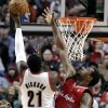 Portland Trail Blazers center J.J. Hickson, left, shoots against Los Angeles Clippers center DeAndre Jordan during the first quarter of an NBA basketball game in Portland, Ore., Saturday, Jan. 26, 2013.(AP Photo/Don Ryan)