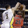 Indiana Pacers guard George Hill, left, blocks the shot over Chicago Bulls guard Marquis Teague during the first half of an NBA basketball game in Indianapolis, Monday, Feb. 4, 2013. (AP Photo/Michael Conroy)